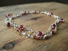 SALE Garnet and Sterling Silver Bracelet by hoitytoitydesigns, $15.00.  HAPPY LEAP DAY<3  Why not spend it shopping? Everything on our Etsy Site today is on sale for 20% off!! Just enter the coupon code LEAPDAY20 in at check out.