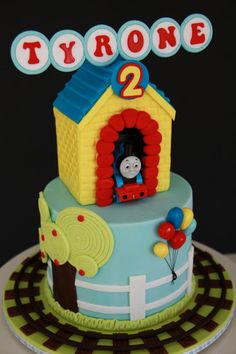 Thomas the Tank Cake. Might be the cutest Thomas cake I've seen. Adorable.