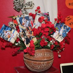 Thinking of using Softballs.Basketball Center Piece: Use old basketball, flowers matching team colors and team pictures placed in arrangement using flower picks-- (Flower foam inside basketball) Ball Birthday Parties, Birthday Party For Teens, Grad Parties, Basketball Crafts, Basketball Party, Basketball Photos, Soccer, Sports Theme Classroom, Senior Night Gifts