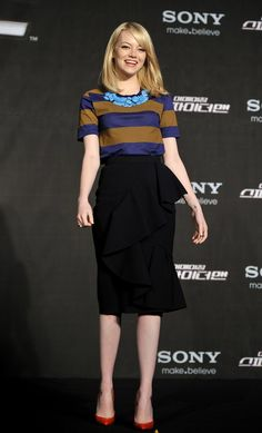 We love Emma's straight-from-the-runway Burberry Prorsum look at the South Korea photocall — the stripes paired with an unexpected pop of red go perfectly together.