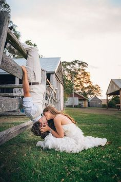 Take a simple kissing photo to the next level by flipping the groom upside down.