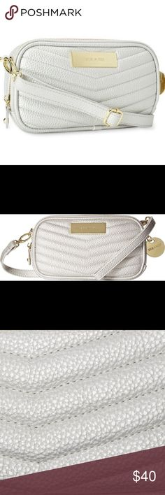 🌻NEW🌻 Steve Madden BMagnolia Chevron Crossbody Update your accessories with this medium silver chevron quilted cross body handbag, * Style: Cross-body bag * Construction: Polyurethane * Exterior: Chevron * Entry: Zip-top closure * Hardware: Goldtone * Lining: Logo printed polyester * Detachable, Adjustable shoulder strap * Exterior pockets: One (1) back slip pocket * Interior pockets: Eight (8) slip pockets and one (1) middle zip pocket * Bag dimensions: 5 inches high x 8.5 inches wide x 2…