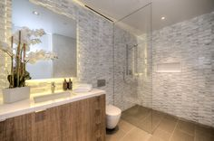 White & Grey textured vertical tiles   Modern bathroom at Carla Ridge in Beverly Hills By Boswell Construction #buildboswell