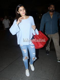 Alia Bhatt's airport style is something all girls can relate to. With comfort being the key and a certain something being a statement accessory, her style is so likable. This time around, we spotted her in a pair of casual ripped denims and a loose top, which looked so comfy.   #bollywood fashion #celebrity pics #celebrity wallpapers #celebs hot pic #fashion news #latest trend. celebs fasion #new trend