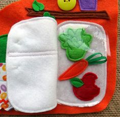 Here's a peek inside the Bunny Fridge. A felt carrot book makes a cute cottage that opens to a kitchen and bedroom.                        Home For a Bunny by LindyJ Design at Etsy.