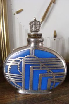 art deco perfume bottle with silver overlay and crown top