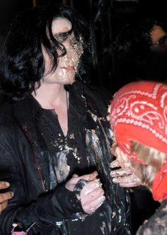 Michael Jackson Photos - The late Michael Jackson photographed on 13th Sept 2003 at a birthday party where the 'King of Pop' got involved in a food fight with Aaron & Nick Carter resulting in him being absolutely caked in cake!. - Michael Jackson in a Food Fight