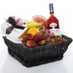 Fruit Gift Hamper Basket $139.00  (A vibrant selection of fresh seasonal fruits. Presented in a lovely wicker tray basket along with a bottle of Stoneleigh Rose wine, and hand made chocolates by Bennetts in Mangawhai .)