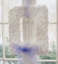 Rectangular wreath made from cotton balls. Wonder if this would look nice in real life?