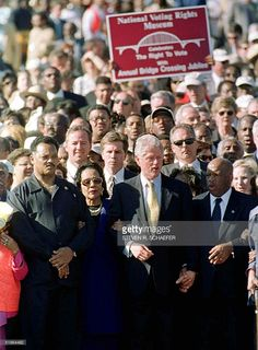Rev. Jesse Jackson, Coretta Scott King, US President Bill Clinton and US Representative John Lewis march across the Edmund Pettus Bridge in Selma, Alabama, 05 March, 2000. Clinton is the first president to commemorate what is called 'Bloody Sunday.' Police using batons and tear gas beat back the black marchers, leaving some 100 bleeding on the bridge, 07 March, 1965. Lewis was at the march and was beaten unconscious.