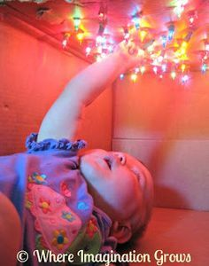 Star box for infants made from a cardboard box and twinkling lights.