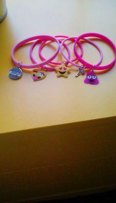 I got this emoji bracelets for my birthday!! Emojis!! I love the purple sparkling poop emoji!!