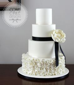 Monochrome ruffles wedding cake in ivory and black with ivory sugar peony. Inspired by Vera Wang dress