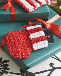 Tiny crocheted stocking to hold a gift card!  Free pattern--Shown in Bernat Happy Holidays.