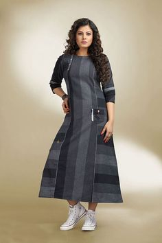 Look sassy as you don this black & grey designer kurti falling with geometric divisions of shades and finished with buttons and thread for appeal! Kurti Designs Party Wear, Kurta Designs, Blouse Designs, Casual Dresses, Fashion Dresses, Stylish Dresses, Kurta Neck Design, Indian Designer Suits, Designer Dresses