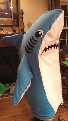 Dont get LEFT behind. This SHARK costume will make you the hit of the party. Costume measures 44. Child size costumes can be made to order. Costume