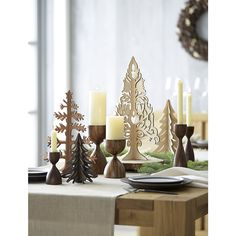 Shop Merritt Tall Pillar Holder.  Hand carved from solid sheesham wood, the Merritt candle holder animates the rich wood grain with a curving, hourglass shape.