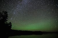 """Airglow over Crooked Lake""<br /> <br /> Airglow, also called nightglow, is a faint emission of light by a planetary atmosphere. It is caused by the sun's ultraviolet light exciting oxygen and nitrogen atoms and molecules high up in the atmosphere. This evening, the green hues were seen in all directions, as meteors streaked across the skies.<br /> ~ Day 187 of Inspired by Wilderness: A Four Season Solo Canoe Journey"