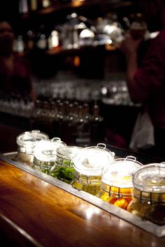 Sealed jars for cocktail garnishes.