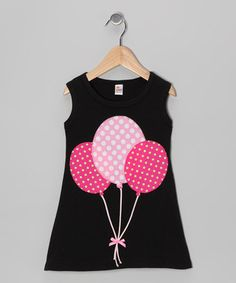 Boasting a peppy polka dot balloon appliqué, this dress is full of fun. Plus, its soft knit fabric creates a comfy feel that any little sugar pie is destined to love.