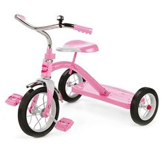 """Ride in style on the Radio Flyer® Classic Pink 10"""" Tricycle™!  This adorable pink tricycle is classically styled and includes chrome handlebars, fender and ringing bell.  This sturdy trike also features steel construction, durable spoked wheels, a 10"""" front wheel and real rubber tires.  The controlled turning radius prevents tipping for safe and confident riding.  It also has a rear step for easy on-and-off.  The adjustable seat grows with your child.<..."""