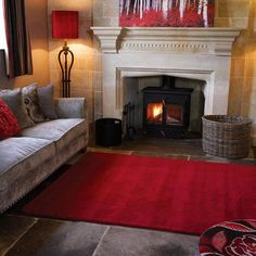 Bela Casa Home Elegant Plain Red Bordered 100% rich natural wool dense pile rug. A simple classic plain border design that has a minimalist understated elegance. The energetic bright red colour will fit a whole range of decor and the deep soft pile will add a luxurious feel underfoot. Available in rectangular rugs 80 x 150, 120 x 170, 160 x 230 and a hallway runner 60 x 230cm