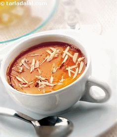 Almond crème brulée,this rich vanilla and almond flavoured custard with a hard golden coloured caramel crust and a soft gooey centre makes a wonderful end to any meal.