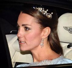 Duchess of Cambridge arriving at a diplomatic reception in Buckingham palace.