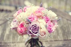 This is pretty! Maybe peonies with purple roses?? (Pink, purple pastels, roses)