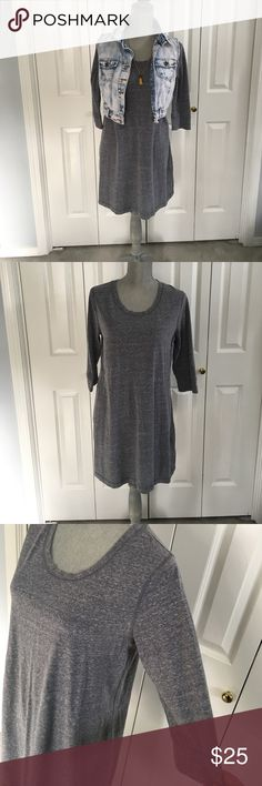 🎉BOGO Gray sweater dress Comfortable gray heather sweater dress! The fabric is heavier than a normal t shirt but not quite as heavy as a sweater. It's a great in between piece that can be worn all seasons! I have worn this in 100+ degree weather as well as 10 degree weather. This is truly an all seasons staple piece! Can be dressed so many different ways! Mossimo Supply Co Dresses Long Sleeve