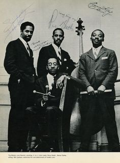 Modern Jazz Quartet signed photo signed by Percy Heath, Milt Jackson, Connie Kay (not in photo) and John Lewis. Kenny Clarke was the original MJQ drummer for two years before Connie Kay.