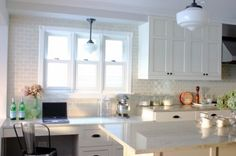 have a little work station in the kitchen with subway tile and a retro chair. it's PERFECT!