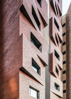 is back - a content partnership with our pals from which this week sees us exploring exceptional examples of high-rise brick and masonry architecture. Here with the jagged brick outcrops of the Edges Apartments in Kuwait by ( Brick Architecture, Amazing Architecture, Architecture Details, Interior Architecture, Brick Masonry, Brick Facade, Facade Design, Exterior Design, Brick Block