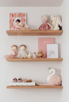 pink, beige and cream nursery decor, wooden shelves