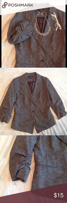Feminine Gray Career Work Blazer Office Attire Excellent condition charcoal gray single button blazer with adorable rouching on each sleeve. Lined. Size large. Looks like tweed but is a polyblend. Perfect for the office. Forever 21 Jackets & Coats Blazers