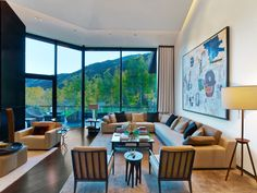Brilliant Living Room Decor At Aspen Art House Near Contemporary Armchairs Along With Grey Sofa Also Contemporary Fireplace Design With Sitting Area