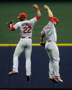 Jason Heyward and Matt Holliday celebrate their 3-0 win after a game against the Milwaukee Brewers. 4-24-15