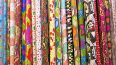 After the holidays, most stores are discounting wrapping paper. You'll get 50% off or more. That inexpensive wrapping paper makes great drawer or shelf liners.