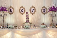 #Backdrop to our Sept 8, Wedding.  I made the L-O-V-E sign with black frames purchased at Ikea which I spray painted gold. #purple wedding