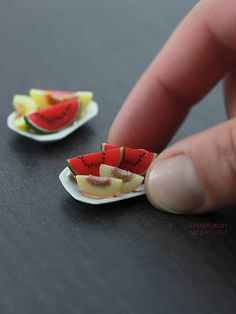 Tiny little plate, featuring cold ice watermelon and cantaloupe. The miniature melon pieces were made from polymer clay, glued on ceramic platter. The platter measures 1 1/16 inch across (thats about 27mm) NOTES ---------- ► All items are handmade from polymer clay in 1:12 scale with fine attention to details. ► Items will ship in protective box. ► This is not a toy. All items contain small parts and were not made for children.