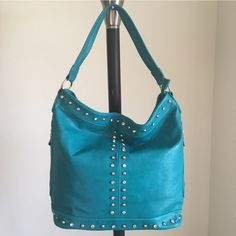 """• Aqua Addict• Handbag  Aqua Addict Brand New Handbag Only ONE of this color and style available! -Brand: sold by Cali&Karma (retails for $90) -Color: teal-ish, turquoise-ish with silver rhinestone hardware  -Dimensions: 15"""" length, 14"""" height, 5.5"""" width -Details: back pocket, two side zippered pockets, interior pocket, two interior pouches, zippered closure -Other: no trades or holds/will not be restocked/open to OFFERS via Posh's offer button :) **soft animal friendly VEGAN LEATHER** Bags…"""
