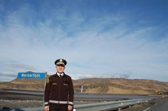 Iceland: Helpless police officer on duty with active volcano Eyjafjallajöküll behind him