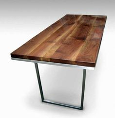 Solid walnut table with steel base legs. $3,400 Product ID : G128669 From Olde Good Things