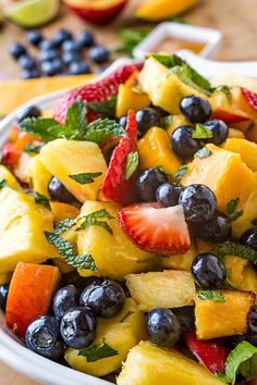Rainbow Fruit Salad- Fresh cut pineapple, mango, and berries come together, which would be plenty delicious and tempting, but it doesn't stop there.
