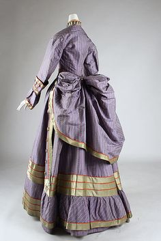 Dress Date: 1872–75 Culture: probably British Medium: silk Dimensions: Length at CB (a): 43 1/2 in. (110.5 cm) Length at CB (b): 48 1/2 in. (123.2 cm) Credit Line: Purchase, Irene Lewisohn Bequest, 1986Dress