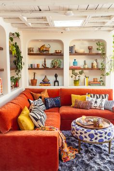 Small space tip! We didn't have room for a wall of bookcases *and* a large sectional sofa in our so we created built ins… Room Colors, House Colors, Wooden Bifold Doors, Large Sectional Sofa, Orange Couch, Built Ins, Decoration, Home Interior Design, Living Room Decor