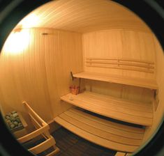 Sauna Room with white Aspen wood paneling and Basswood benches.  http://www.saunaplanning.com/