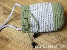Crochet Drawstring Bag with yarn made from an old T-shirt! The how to for the yarn is on the same site. Love this idea for a yarn substitute. Think I'll make a rug too.