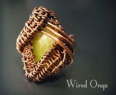 Fantasy inspired, adjustable ring made in handmade oxyded copper, wire weaving technique. The ring mounts a lemon jade natural stone that seems as a dragon eye.  Completely hand made