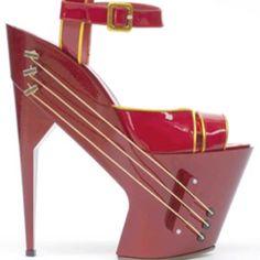 Guitar platform shoe. Whever u get the urge to bust out a ballot, ya got ur guitar shoes